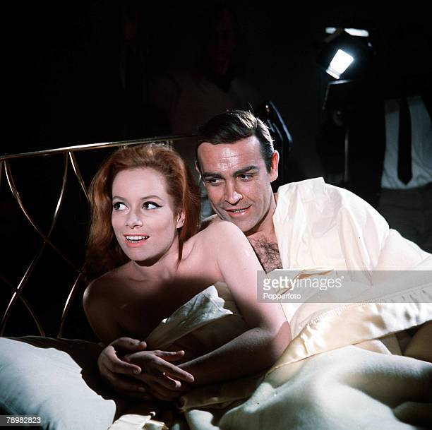 Sean Connery and Luciana Paluzzi being photographed in bed on the set of the James Bond film 'Thunderball' 8th March 1965