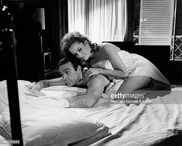 Sean Connery and Luciana Paluzzi in bed in a scene from Thunderball fourth episode of James Bond's series London March 1965