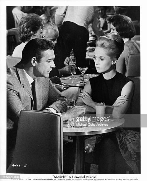 Sean Connery and Tippi Hedren having drinks in a scene from the film 'Marnie' 1964