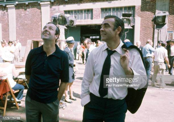 Sean Connery as James Bond during the filming of Diamonds Are Forever, alongside the director Guy Hamilton, at Southampton Docks in Southampton,...