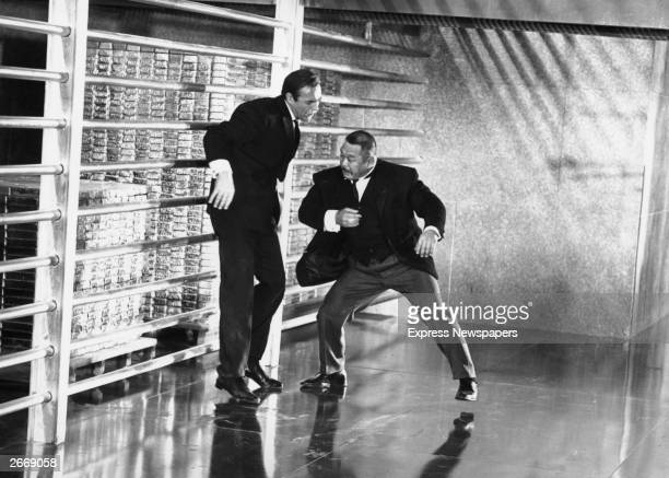 Sean Connery as James Bond fights with Harold Sakata as Oddjob in the film 'Goldfinger' directed by Guy Hamilton and produced by United Artists