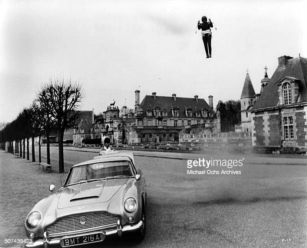 Sean Connery as James Bond flies a jet pack to his car in a scene from the movie Thunderball circa 1965