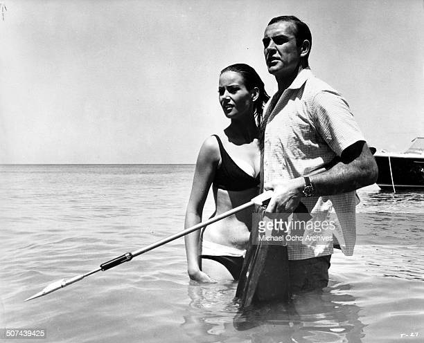 Sean Connery as James Bond protects Claudine Auger as Domino in a scene from the movie Thunderball circa 1965