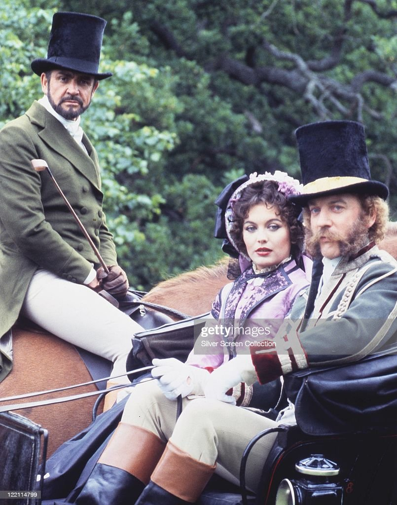 Sean Connery, British actor, on horseback, with Lesley-Anne Down, British actress, and Donald Sutherland, Canadian actor, riding in a carriage, all dressed in period costume with Connery and Sutherland wearing black top hats, in a publicity portrait issued for the film, 'The First Great Train Robbery', 1979. The action adventure film, directed by Michael Crichton (1942–2008), who adaped it from his own novel, starred Connery as 'Pierce', Down as 'Miriam', and Sutherland as 'Agar'.