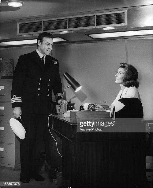 Sean Connery dressed in a military uniform talking to Lois Maxwell in a scene from the film 'You Only Live Twice' 1967