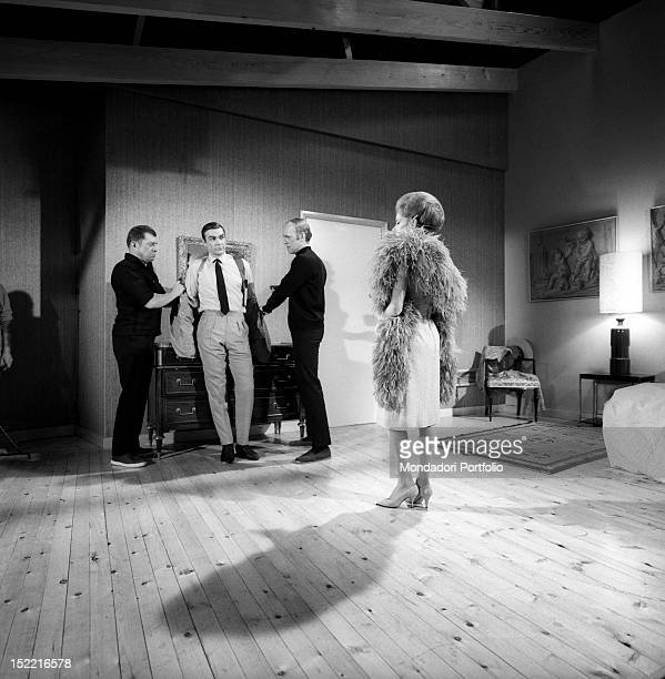 Sean Connery, flanked by actors Michael Brennan and Philip Locke, who play two killers, and Luciana Paluzzi shoot an action shot from Thunderball,...