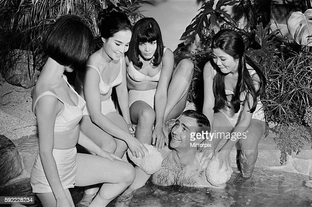Sean Connery in his roles as James Bond being washed by a group of ladies in a scene from the film You Only Live Twice during filming at Pinewood...