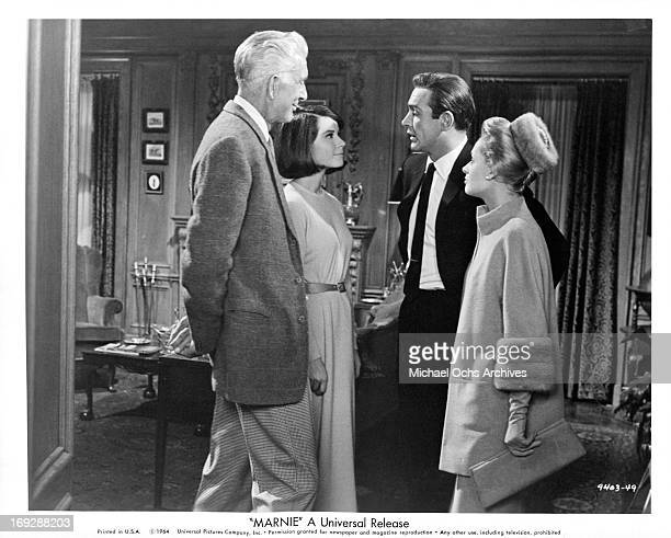 Sean Connery introduces his bride to be Tippi Hedren to his father Alan Napier and his sisterinlaw Diane Baker in a scene from the film 'Marnie' 1964
