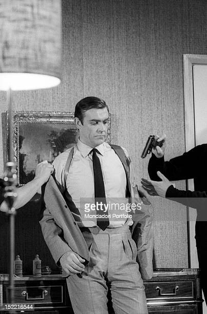Sean Connery is helped to dress the part of secret agent James Bond in Thunderball fourth episode of 007 series Pinewood march 1965