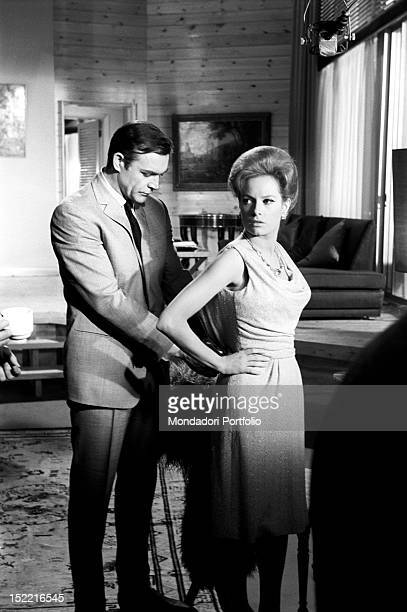 Sean Connery on the set of Thunderball, fourth episode of secret agent 007's series, prepares himself to shoot a scene of the film with Luciana...
