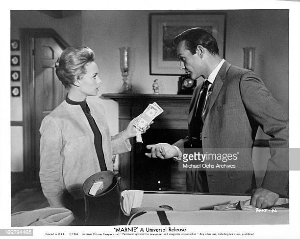 Sean Connery persuades Tippi Hedren to return the money she had taken from the company safe in a scene from the film 'Marnie' 1964