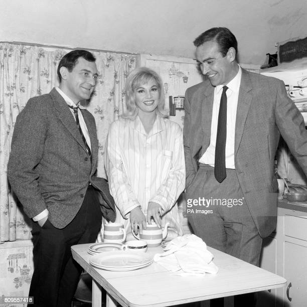 Sean Connery visiting his wife Diane Cilento and Harry H Corbett left on the set of the film 'Rattle of a Simple Man' at Elstree