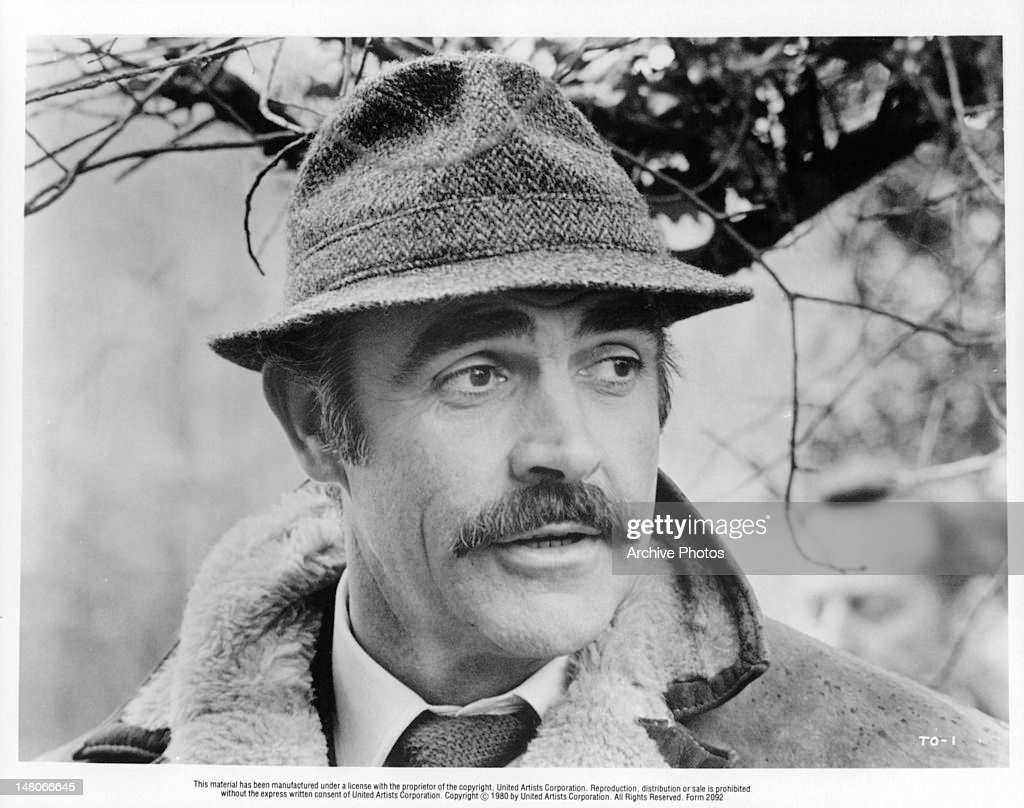 Sean Connery with a moustache and wearing a hat in a scene from the film 'The Offense', 1973.