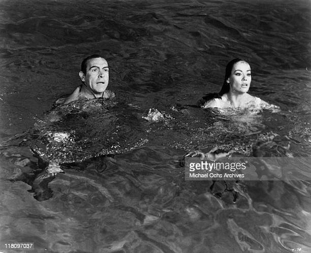 Sean Connery with Claudine Auger in the water in a scene from the film 'Thunderball' 1965
