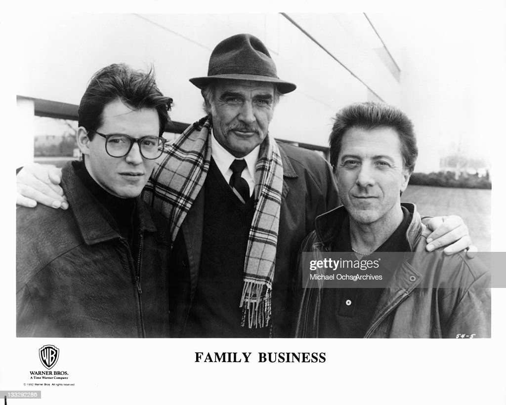 Sean Connery with his arms around Matthew Broderick and Dustin Hoffman in a scene from the film 'Family Business', 1989.