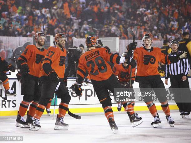Sean Couturier Justin Bailey Claude Giroux and Robert Hagg of the Philadelphia Flyers celebrate Giroux's overtime goal against the Pittsburgh...