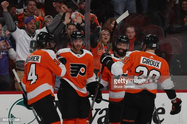 Sean Couturier Michael Raffl Radko Gudas and Claude Giroux of the Philadelphia Flyers celebrate a goal by Raffl at 1753 of the second period against...
