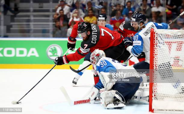 Sean Couturier of Canada challenges Kevin Lankinen of Finland during the 2019 IIHF Ice Hockey World Championship Slovakia final game between Canada...