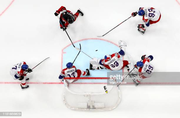 Sean Couturier of Canada challenges Pavel Francouz goaltender of Czech Republic during the 2019 IIHF Ice Hockey World Championship Slovakia semi...