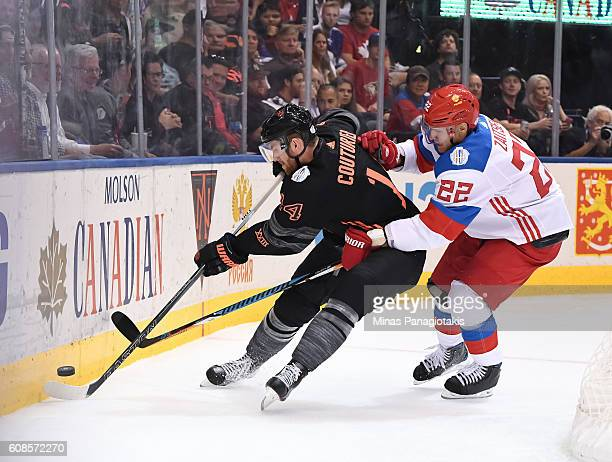 Sean Couturier of Team North America battles for a loose puck with Nikita Zaitsev of Team Russia during the World Cup of Hockey 2016 at Air Canada...