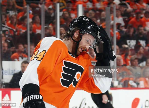 Sean Couturier of the Philadelphia Flyers adjusts his helmet during the second period against the Pittsburgh Penguins in Game Three of the Eastern...