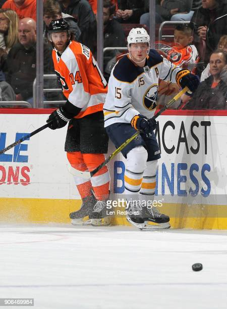 Sean Couturier of the Philadelphia Flyers and Jack Eichel of the Buffalo Sabres keep their eye on the loose puck against on January 7 2018 at the...