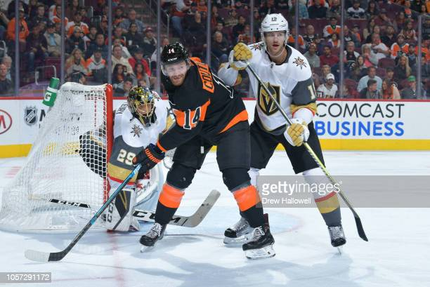 Sean Couturier of the Philadelphia Flyers and Jon Merrill of the Vegas Golden Knights get set in from of Knights goalie MarcAndre Fleury at the Wells...
