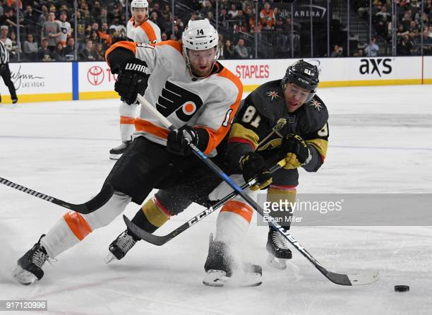 Sean Couturier of the Philadelphia Flyers and Jonathan Marchessault of the Vegas Golden Knights battle for the puck in the first period of their game...
