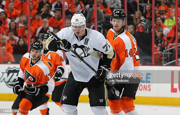 Sean Couturier of the Philadelphia Flyers battles against Evgeni Malkin of the Pittsburgh Penguins in Game Six of the Eastern Conference...