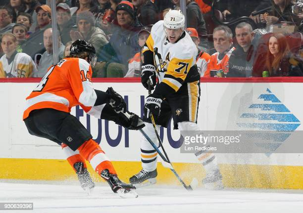 Sean Couturier of the Philadelphia Flyers battles against Evgeni Malkin of the Pittsburgh Penguins on March 7 2018 at the Wells Fargo Center in...