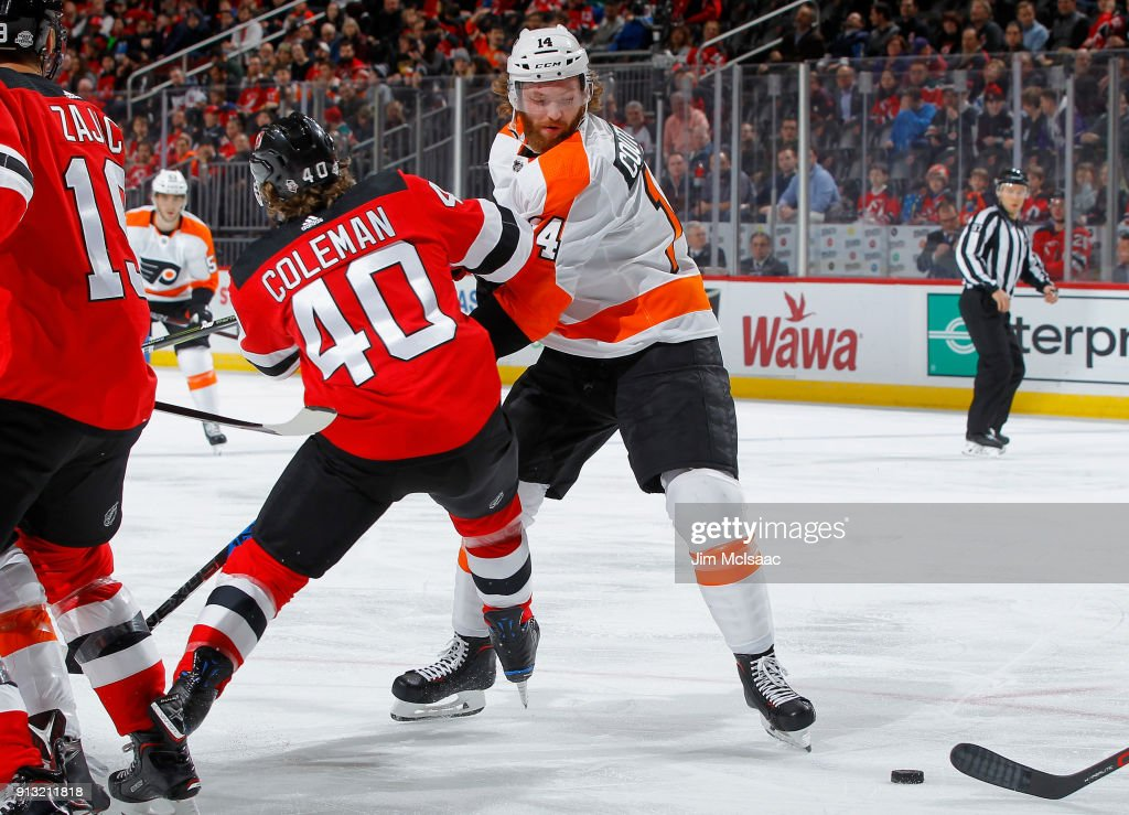 Sean Couturier #14 of the Philadelphia Flyers battles for the puck against Blake Coleman #40 of the New Jersey Devils on February 1, 2018 at Prudential Center in Newark, New Jersey.