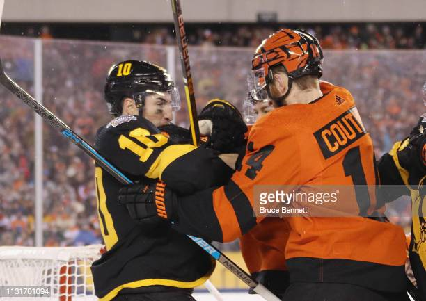 Sean Couturier of the Philadelphia Flyers battles with Garrett Wilson of the Pittsburgh Penguins during the first period during the 2019 Coors Light...