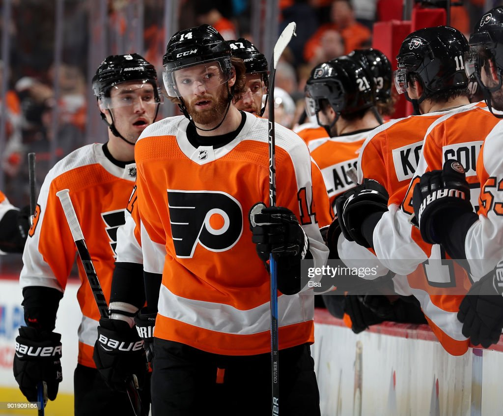 Sean Couturier #14 of the Philadelphia Flyers celebrates his empty net goal with teammates on the bench in the third period against the St. Louis Blues on January 6, 2018 at Wells Fargo Center in Philadelphia, Pennsylvania.The Philadelphia Flyers defeated the St. Louis Blues 6-3.