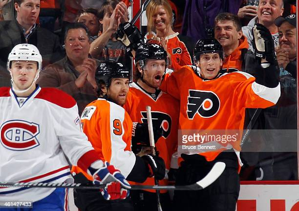 Sean Couturier of the Philadelphia Flyers celebrates his first period goal against the Montreal Canadiens along with Steve Downie and Vincent...