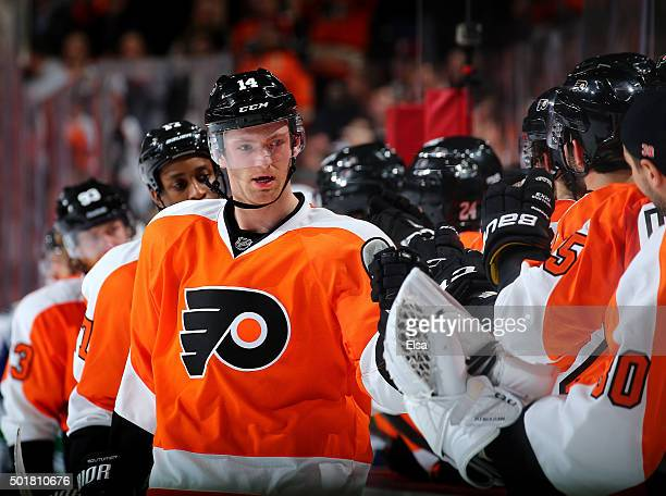 Sean Couturier of the Philadelphia Flyers celebrates his goal with teammates on the bench in the third period against the Vancouver Canucks on...