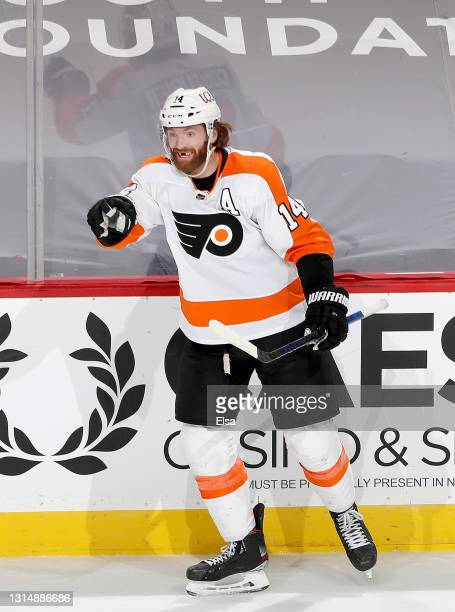 Sean Couturier of the Philadelphia Flyers celebrates his unassisted goal in the third period against the New Jersey Devils at Prudential Center on...