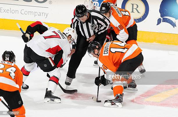 Sean Couturier of the Philadelphia Flyers controls the puck on a faceoff against Kyle Turris of the Ottawa Senators on January 6 2015 at the Wells...