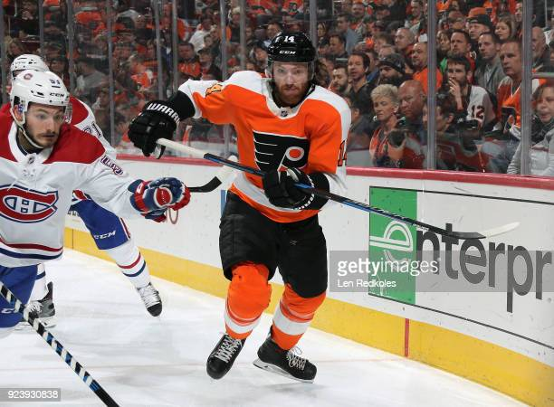 Sean Couturier of the Philadelphia Flyers in action against Victor Mete of the Montreal Canadiens on February 20 2018 at the Wells Fargo Center in...
