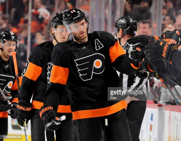 Sean Couturier of the Philadelphia Flyers is congratulated by teammates on the bench after he scored a goal in the third period against the Chicago...