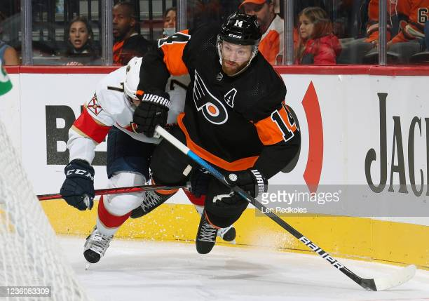 Sean Couturier of the Philadelphia Flyers is sent airborn after colliding with Radko Gudas of the Florida Panthers in the corner at the Wells Fargo...
