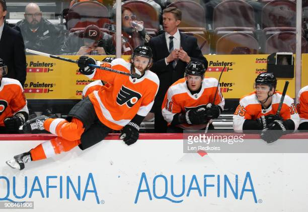 Sean Couturier of the Philadelphia Flyers jumps to the ice on a shift change with Head Coach Dave Hakstol Travis Konecny and Jori Lehtera following...