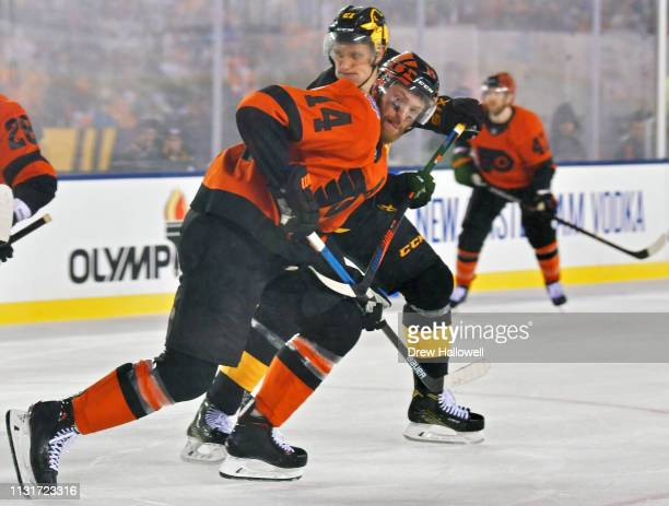 Sean Couturier of the Philadelphia Flyers pushes past Nick Bjugstad of the Pittsburgh Penguins in the third period during the 2019 Coors Light NHL...