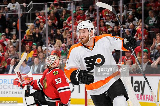 Sean Couturier of the Philadelphia Flyers reacts after assisting in scoring on goalie Scott Darling of the Chicago Blackhawks in the third period of...