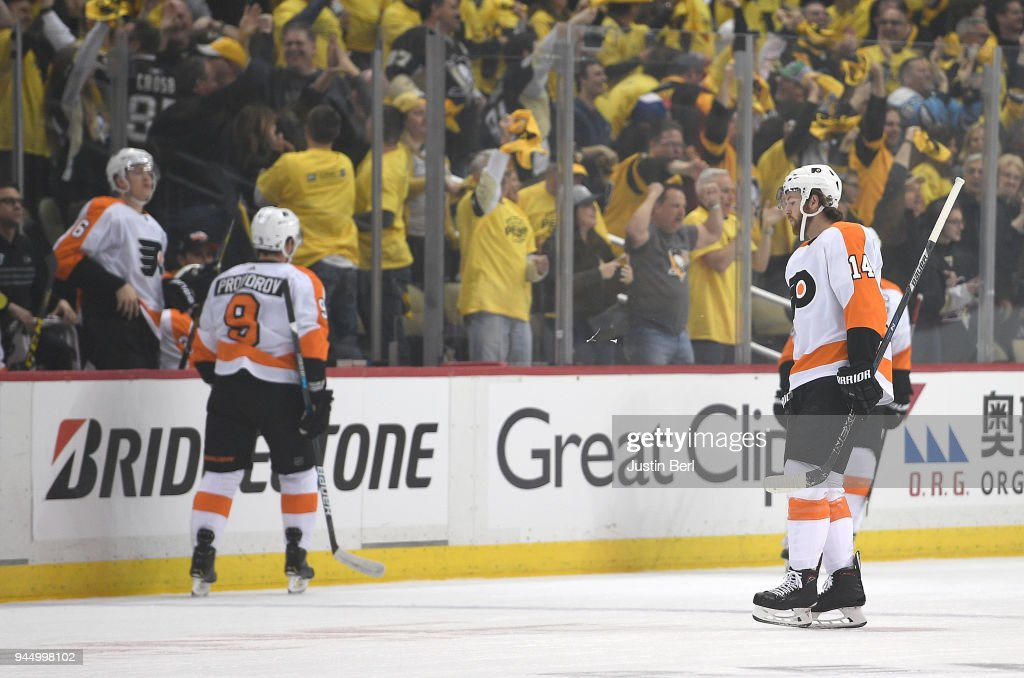 Sean Couturier #14 of the Philadelphia Flyers reacts as he heads to the bench following a goal by Carl Hagelin #62 of the Pittsburgh Penguins during the first period in Game One of the Eastern Conference First Round during the 2018 NHL Stanley Cup Playoffs at PPG PAINTS Arena on April 11, 2018 in Pittsburgh, Pennsylvania.