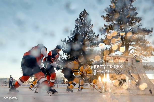 Sean Couturier of the Philadelphia Flyers scores a first period goal past Tuukka Rask of the Boston Bruins during the 'NHL Outdoors At Lake Tahoe' at...