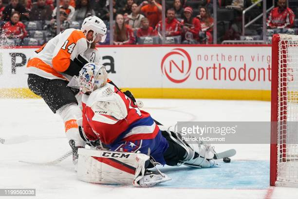 Sean Couturier of the Philadelphia Flyers scores a goal against Braden Holtby of the Washington Capitals in the second period at Capital One Arena on...