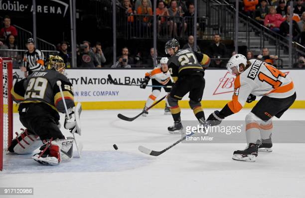 Sean Couturier of the Philadelphia Flyers scores a goal against MarcAndre Fleury of the Vegas Golden Knights in the first period of their game at...