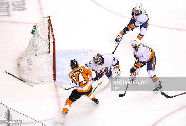 Sean Couturier of the Philadelphia Flyers scores a goal past Semyon Varlamov of the New York Islanders during the first period in Game Two of the...