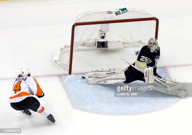 Sean Couturier of the Philadelphia Flyers scores hat trick against MarcAndre Fleury of the Pittsburgh Penguins in Game Two of the Eastern Conference...