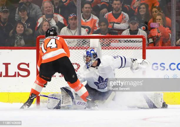 Sean Couturier of the Philadelphia Flyers scores the game winning goal in the shootout against Frederik Andersen of the Toronto Maple Leafs at the...